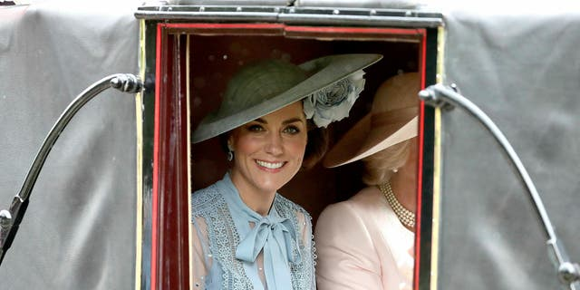 Britain's Kate, Duchess of Cambridge looks out from a carriage in Windsor Great Park on her way to Royal Ascot horse race meeting in Ascot, England, Tuesday, June 18, 2019. (Steve Parsons/PA via AP)
