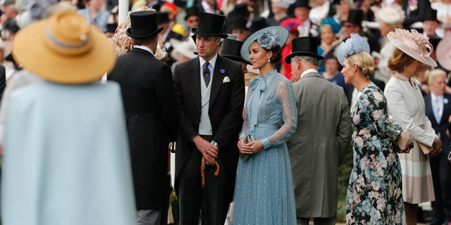 Britain's Prince William, center, and Kate, Duchess of Cambridge, arrive on the day one of the annual Royal Ascot horse race meeting in Ascot, England, Tuesday, June 18, 2019. (AP Photo/Alastair Grant)