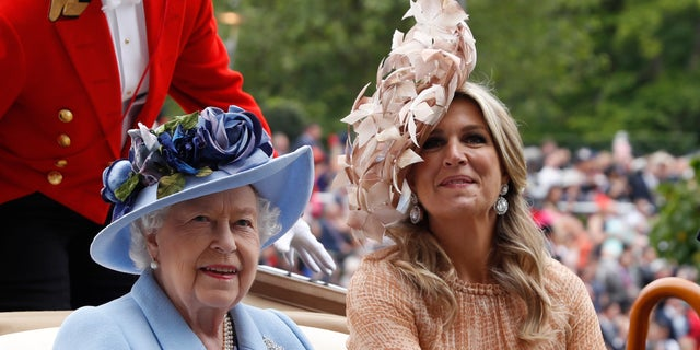 Queen Elizabeth II and Netherlands' Queen Maxima arrive on a day one of a annual Royal Ascot equine competition assembly in Ascot, England. (AP Photo/Alastair Grant)