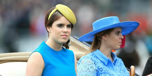 Princess Eugenie, left, and Princess Beatrice demeanour out from a carriage during Royal Ascot equine competition assembly in Ascot, England. (Mike Egerton/PA around AP)