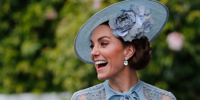 Britain's Kate, Duchess of Cambridge, smiles on her attainment on a day one of a annual Royal Ascot equine competition assembly in Ascot, England, Tuesday, Jun 18, 2019. (AP Photo/Alastair Grant)