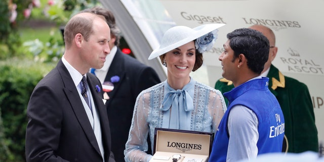 Britain's Prince William and Kate, Duchess of Cambridge, benefaction winners with their trophy's for a Kings Stand stakes competition during a day one of a annual Royal Ascot. (AP Photo/Alastair Grant)