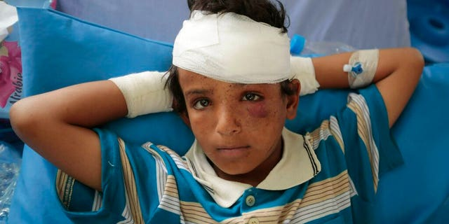 In this Aug. 12, 2018, file, photo, A child injured in a deadly Saudi-led coalition airstrike on Thursday rests in a hospital in Saada, Yemen. A database tracking violence said Wednesday, June 19, 2019 that at least 91,600 people have been killed in Yemen's civil war, presenting a new estimate after completing reporting for the first months of fighting in 2015.