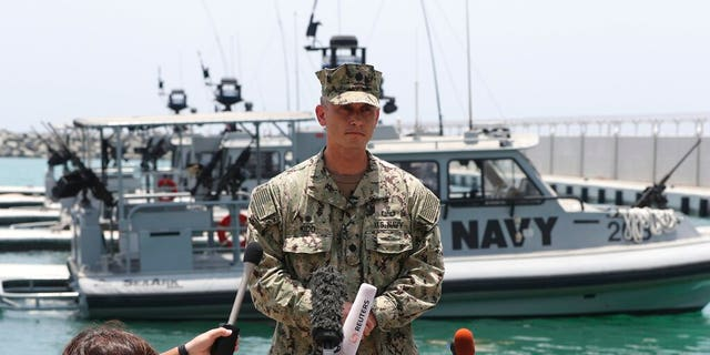 """Cmdr. Sean Kido of the U.S. Navy's 5th Fleet talks to journalists at a 5th Fleet Base near Fujairah, United Arab Emirates, Wednesday, June 19, 2019. Cmdr. Kido said Wednesday that damage done last week to the Kokaku Courageous was """"not consistent with an external flying object hitting the ship."""""""