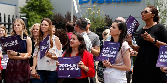 Pro-life activists outside a Planned Parenthood clinic in St. Louis.