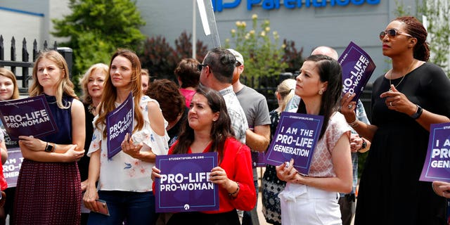 Earlier this month, anti-abortion advocates gather outside the Planned Parenthood clinic in St. Louis. Missouri's only abortion clinic. (AP Photo/Jeff Roberson, File)