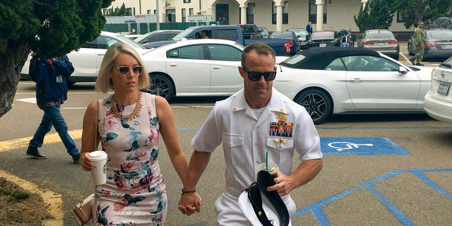 Navy Special Operations Chief Edward Gallagher, right, walks with his wife, Andrea Gallagher, as they arrive to military court on Naval Base San Diego, Thursday, June 20, 2019, in San Diego. (AP Photo/Julie Watson)