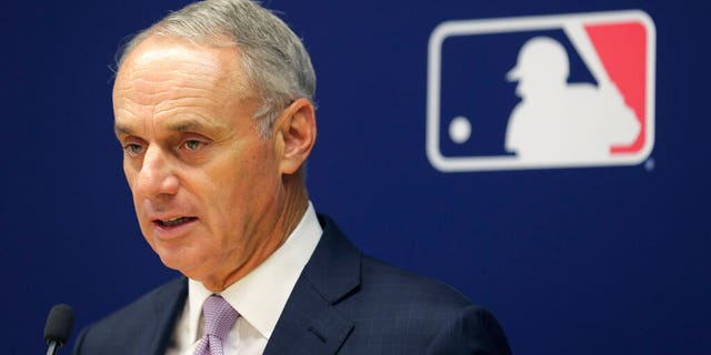 Major League Baseball Commissioner Rob Manfred speaks to reporters in New York City on Thursday. (Associated Press)