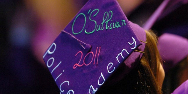 In this June 6, 2011, file photo, Tara O'Sullivan decorated her mortarboard with her police academy plans at College Park High School's commencement ceremony in Concord, Calif. (Karl Mondon/Bay Area News Group via AP, File)