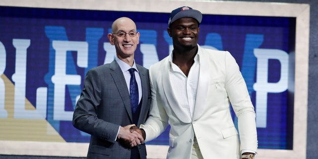 Duke's Zion Williamson, right, poses with NBA Commissioner Adam Silver after he was taken with the first overall pick. (AP Photo/Julio Cortez)