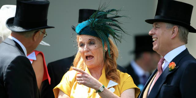Britain's Prince Andrew, right, and Sarah, Duchess of York arrive during day four of Royal Ascot at Ascot Racecourse in Ascot, England, in 2019.