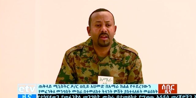 Ethiopia's Prime Minister Abiy Ahmed announces a failed coup as he addresses the public on television, Sunday, June 23, 2019. The failed coup in the Amhara region was led by a high-ranking military official and others within the country's military, the prime minister told the state broadcaster.