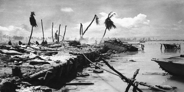 FILE - In this November 1943 file photo, bodies and wrecked amphibious tractors litter a battlefield, after U.S. Marines from the 2nd Division forced back the Japanese on Betio island in the Tarawa Atoll, Kiribati. (AP Photo, File)