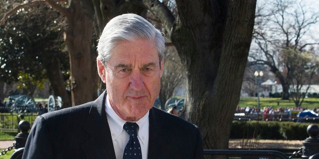 Then-special counsel Robert Mueller walking past the White House in March 2019. (AP Photo/Cliff Owen, File)