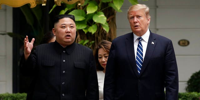 FILE: U.S. President Donald Trump and North Korean leader Kim Jong Un take a walk after their first meeting at the Sofitel Legend Metropole Hanoi hotel, in Hanoi, Vietnam.