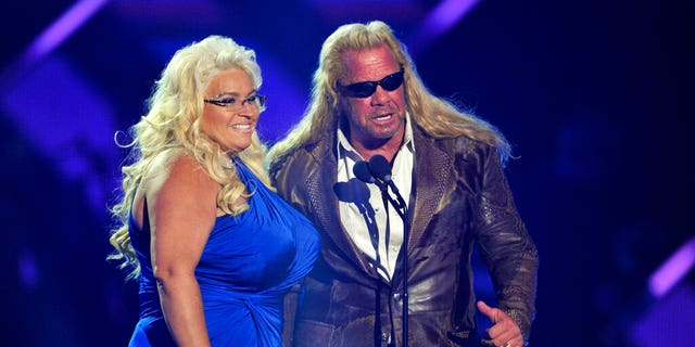 "Duane ""Dog"" Chapman and Beth Chapman present the award for CMT performance of the year at the CMT Music Awards at Bridgestone Arena in Nashville, Tenn., on June 5, 2013."