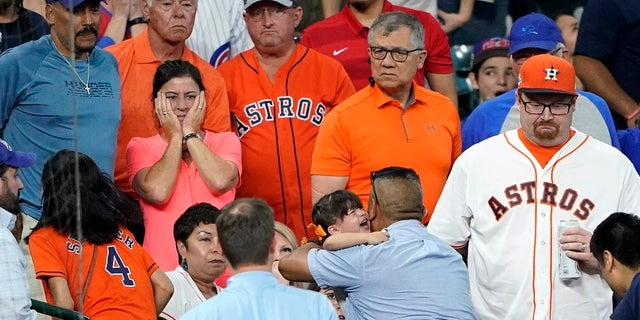 FILE - In this Wednesday, May 29, 2019, file photo, a young child is carried from the stands after being injured by a foul ball off the bat of Chicago Cubs' Albert Almora Jr. during the fourth inning of a baseball game against the Houston Astros, in Houston. (AP Photo/David J. Phillip, File)