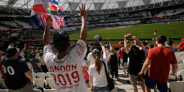 Fans cheer during batting practice before a baseball game between the Boston Red Sox and the New York Yankees. Major League Baseball makes its European debut today at London Stadium.