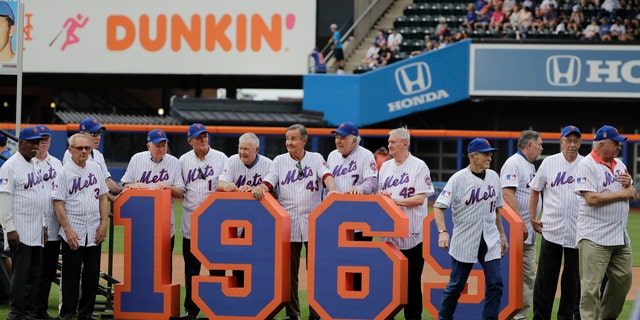 The 1969 Mets leave the field after a pre-game ceremony to honor them before a baseball game against the Atlanta Braves on Saturday. (AP Photo/Frank Franklin II)