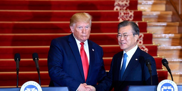 President Donald Trump, left, and South Korean President Moon Jae-in shake hands following their news conference at the Blue House in Seoul, Sunday, June 30, 2019. (Associated Press)
