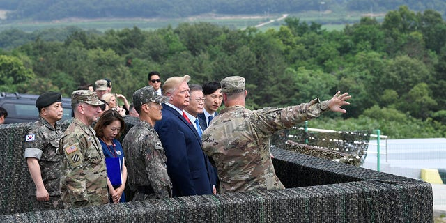 President Donald Trump views North Korea from the Korean Demilitarized Zone from Observation Post Ouellette at Camp Bonifas in South Korea, Sunday, June 30, 2019. (Associated Press)