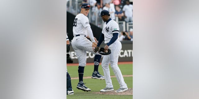 New York Yankees right fielder Aaron Judge, left, and relief pitcher Aroldis Chapman celebrating after their 12-8 win in London on Sunday.