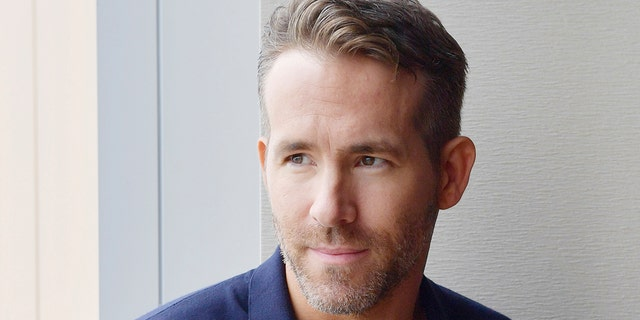 Ryan Reynolds, a Canadian actor and film producer, presents a photo in an interview with Yomiuri Shimbun in Tokyo on May 30, 2018. Reynolds was selected on the Sexful Man Alive lists in 2008 and 2009 and received the highest honor in 2010. (Yomiuri Shimbun via AP images )