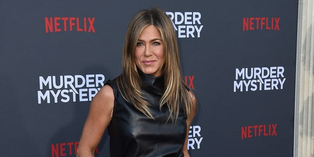 "Cast member Jennifer Aniston arrives at the Los Angeles premiere of ""Murder Mystery"" at the Regency Village Theatre on Monday, June 10, 2019 in Westwood, Calif. (Photo by Jordan Strauss/Invision/AP)"