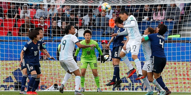 Argentina's Mariela Coronel, core right, and Japan's Hina Sugita fighting for a round during a match. (AP Photo/Thibault Camus)