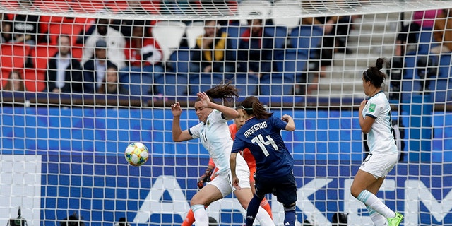 Japan's Yui Hasegawa, center, unwell to measure past Argentina's Florencia Bonsegundo during a Women's World Cup soccer match. (AP Photo/Alessandra Tarantino)