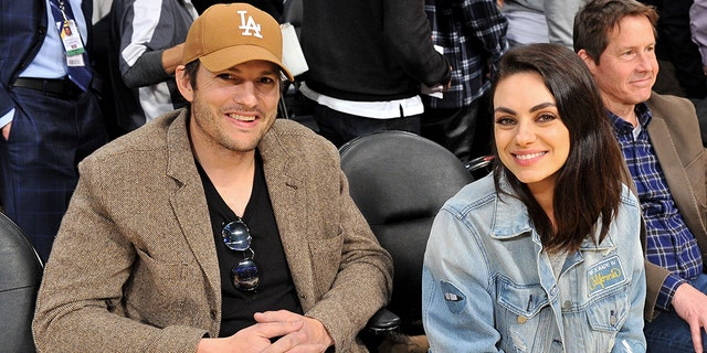 Ashton Kutcher and Mila Kunis attend a basketball game between the Los Angeles Lakers and the Philadelphia 76ers at Staples Center on January 29, 2019 in Los Angeles, California.