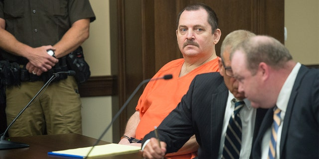 "Fifty-two-year-old Aubrey Trail yelled ""Bailey is innocent, and I curse you all"" Monday before slashing his neck in the courtroom, reports said. (Eric Gregory/Lincoln Journal Star via AP, File)"