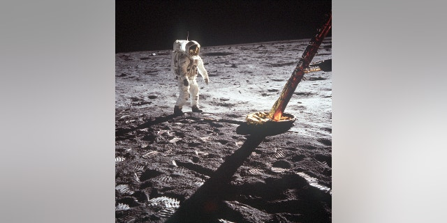 Buzz Aldrin walks on the surface of the moon near a leg of the lunar module in this photo snapped by fellow Apollo 11 astronaut Neil Armstrong.