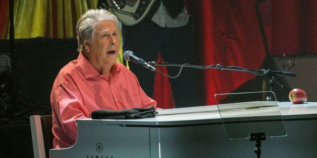 """Brian Wilson, pictured here in August 2017, has postponed his June tour. The Beach Boys co-founder cited """"unforeseen health issues"""" in a statement on Thursday."""