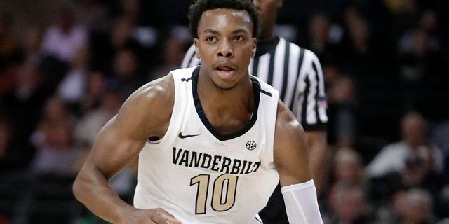 Ja Morant, Darius Garland and Coby White make up a clear top tier of point guards in next week's NBA draft, though one has barely played in the past year. (AP Photo/Mark Humphrey, File)