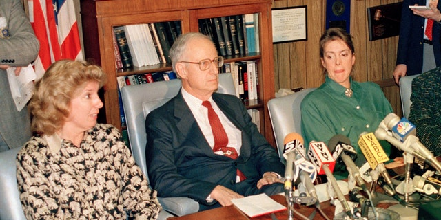 In this March 26, 1988 file photo, prosecutor Linda Fairstein, left, is shown during a news conference in New York. Fairstein was the top Manhattan sex crimes prosecutor when five teenagers were wrongly charged with the 1989 rape and beating of a woman jogging in New York's Central Park. Seated at the table from left are Fairstein, District Attorney Robert Morgenthau, and Ellen Levin, whose daughter Jennifer Levin was murdered in 1986. (AP Photo/Charles Wenzelberg, File)