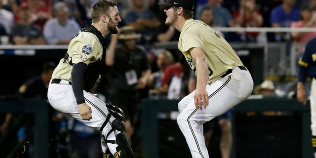 Vanderbilt's Philip Clarke, left, celebrates with Jake Eder after Vanderbilt degraded Michigan in Game 3 of a NCAA College World Series ball finals in Omaha, Neb., Wednesday, Jun 26, 2019. (Associated Press)