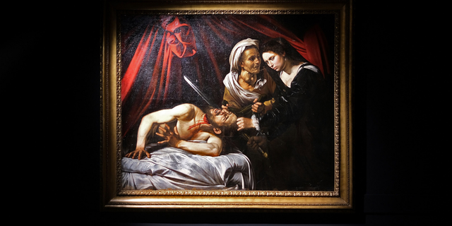 """A painting believed by some experts to be Caravaggio's """"Judith Beheading Holofernes"""" is pictured at the Marc Labarbe auction house on June 15, 2019, in Toulouse, France."""