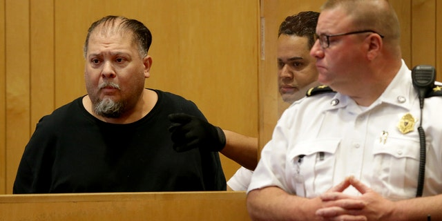 Carlos Rivera, left, appears at his arraignment at Lawrence District Court in Lawrence, MA on May 28, 2019. (Photo by Jonathan Wiggs/The Boston Globe via Getty Images)