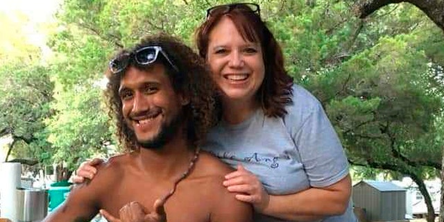 This June 2019 photo provided by Natacha Mendenhall shows Casey Williamson, left, and his mother Carla Ajaga in Possum Kingdom Lake, Texas. Mendenhall said her cousin Williamson, who worked at Oahu Parachute Center, was on board the skydiving plane that crashed Friday evening. (AP/Natacha Mendenhall)