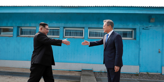 "North Korean leader Kim Jong Un, left, prepares to shake hands with South Korean President Moon Jae-in over the military demarcation line in 2018. <br data-cke-eol=""1"">