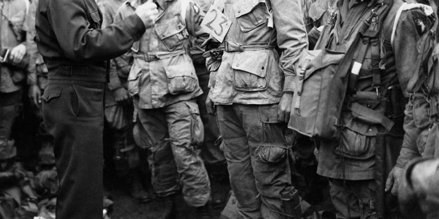 In this June 6, 1944, file photo, U.S. Gen. Dwight D. Eisenhower, left, gives the order of the day to paratroopers in England prior to boarding their planes to participate in the first assault of the Normandy invasion. (U.S. Army Signal Corps via AP)