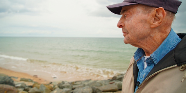 D-Day survivor Ray Lambert looks out over Omaha Beach in June. (AP Photo/Allen G. Breed)