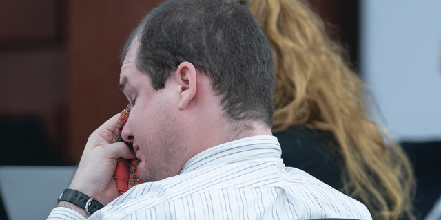 Tim Jones, Jr. wipes his eyes while hearing his grandmother testify during the sentencing phase of his trial in Lexington, S.C., Monday, June 10, 2019. Timothy Jones, Jr. was found guilty of killing his 5 young children in 2014. (Tracy Glantz/The State via AP, Pool)