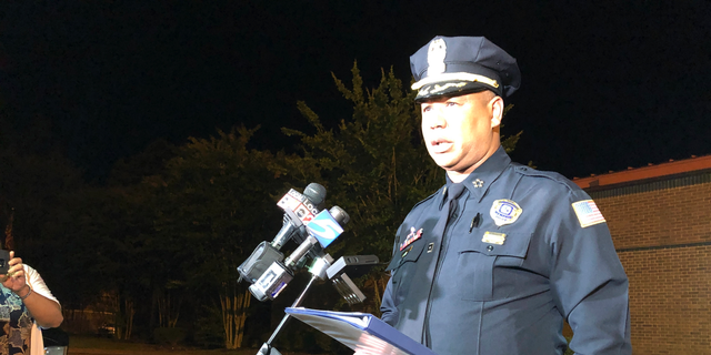 Memphis Police Director Michael Rallings speaks to reporters after a late Wednesday clash with police and an angry crowd early Thursday, June 13, 2019, in Memphis, Tennessee. Armed officers and an angry crowd faced off late Wednesday night after reports that at least one man was fatally shot by authorities in a working-class north Memphis neighborhood. (AP Photo/Adrian Sainz)