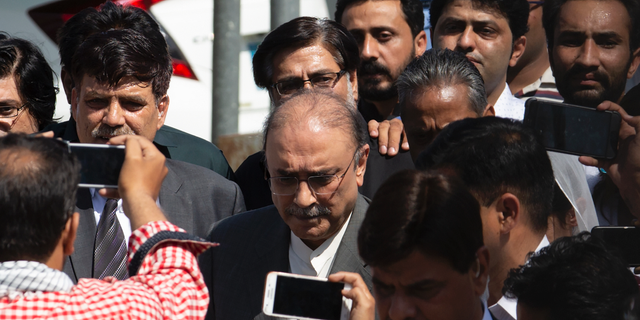 Former Pakistani president and currently a lawmaker in Parliament and leader of Pakistan People's party, Asif Ali Zardari, center, leaves the High Court building, in Islamabad, Pakistan, Monday, June 10, 2019. A Pakistani court has rejected a request by Zardari and his sister Faryal Talpur, for an extension of their bail that would allow them to remain free despite facing a multimillion-dollar money laundering case. (AP Photo/B.K. Bangash)