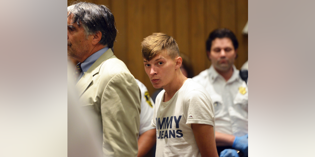 Volodymyr Zhukovskyy, of West Springfield, Mass., stands during his arraignment in Hampton District Court, June 24, 2019, in Springfield, Mass. (Associated Press)