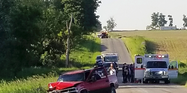 A damaged truck sits on the side of the road after an accident involving a horse-drawn carriage on Friday, June 7, 2019. Michigan State Police said the pickup truck was headed southbound when the driver rear-ended an Amish, horse-drawn carriage. Two adults and five children were ejected from the carriage.