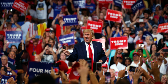 President Donald Trump reacts to the crowd after speaking at his re-election kickoff rally at the Amway Center, Tuesday, June 18, 2019, in Orlando, Fla. (AP Photo/Evan Vucci)