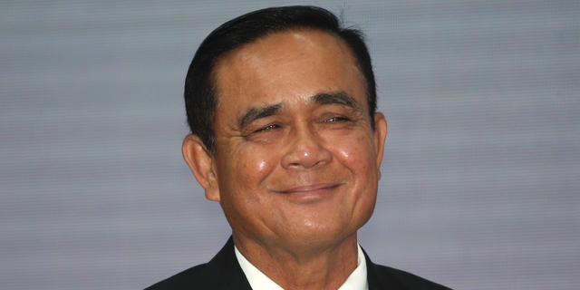 FILE - In this 5, 2019, file photo, Thailand's Prime Minister Prayuth Chan-ocha smiles after the speech for the opening ceremony of Anti-Human Trafficking Day in Bangkok, Thailand. On Tuesday, Prayuth has been officially proclaimed prime minister after the king endorsed Parliament's vote to allow him to keep the position. (AP Photo/Sakchai Lalit, File)
